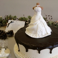 Wedding Dress chocolate cake with strawberry custard, butter cream frosting and ganache with the brides gown in rct covered in fondant