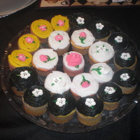 Random Cupcakes   Buttercreme Cupcakes with Royal Icing flowers Banana cupcakes filled with cocunut creme strawberry cupcakes filled with banana creme