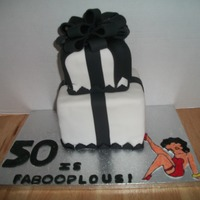 50 Is Faboopulous Black & White Betty Boop themed birthday cake for my step mom's 50th birthday.I cut and drew Betty by hand on fondant and colored...