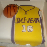 La Lakers Basketball Shirt Birthday cake for a 16 year old Lakers fan. Basketball is made from rice krispies squares covered with fondant. TFL!