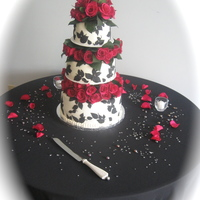 Black And White Fondant With Rose Tiers And Topper From a Martha Stewart design the bride found and loved. We changed it a little to incorporate two rose tiers and topper. White fondant...