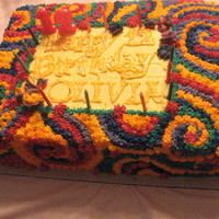 Tie Dye Birthday Cake Two layer rectangular chocolate and vanilla cake with star-tipped tie dye buttercream.