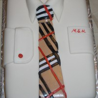 Shirt And Burberry Tie Cake Dress shirt with a Burberry tie, monogrammed pocket and cufflink. The shirt label represented the university colours.