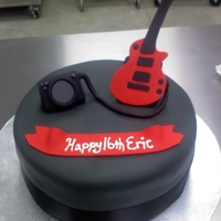 Guitar Themed Cake Chocolate cake covered in grey fondant (actually used Duff's new fondant because I was in a pinch and loved it!! It is buttercream...