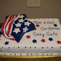 Patriotic Sheet Cake   This cake was for a party for a family that had 2 sons being deployed to Afghanistan at the same time. It was my first sheet cake.