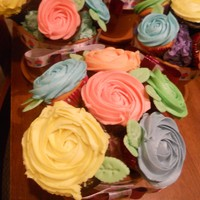 Rainbow Cupcake Bouquets Chocolate and White (done as a rainbow) cupcakes with rainbow ABC as frosting. Done with a rainbow cake for my friend's daughter'...