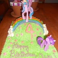 Unicorns And Rainbows Chocolate cake baked in a Pyrex bowl and decorated with ABC. Done as a present for a friend's daughter's 4th birthday. She...