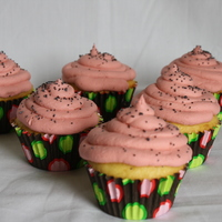 Pucker Up! Lemon cupcakes filled with Lemon curd. Iced with a Raspberry Cream Cheese SMBC and garnished with Poppy Seeds!