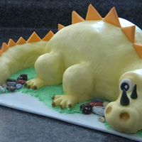 Yellow Dino   Carved cake, with mmf. Idea copied from pic provided by birthday girl's mom (thanks to the creator!) rkt legs and tip of tail.