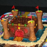 "Knight's Castle Cake After my daughter's castle cake was such a hit, my son wanted a ""boy"" castle (obiously NO PINK) for his Knight Birthday..."