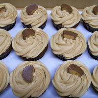 Peanut Butter Cup Cupcakes Chocolate cupcakes with Peanut Butter frostingand topped with 1/2 a Reese's cup