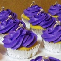 Purple Bridal Shower Cupcakes Vanilla cake with purple buttercream. Topped with diamond ring accents.