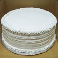 Simple White Whipped Cream Frosting Cake This is my first time using whipped cream frosting. I bought Bettercreme from a local cake supply store and thought it was wonderful to use...