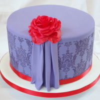 Purple Damask Cake Red gumpaste flower, royal icing stencilled pattern