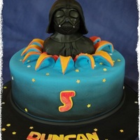 Darth Vader Cake  Dark chocolate mudcake with chocolate ganache and fondant. DV is made from RKT covered with moulded chocolate fondant and airbrushed black...