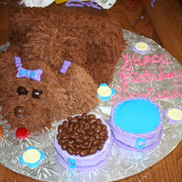 8 Yr Olds Birthday Puppy Cake I used the puppy tutorial on CC and it was really easy to make. A lot of fun too. The dog bowls are cake as well and fondant covered.