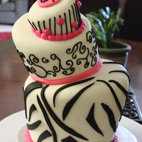 Zebra Print Topsy Turvy This is a cake I made for a friend. The top tier is a cupcake and I used a youtube video to help me with carving out the cake to give it...