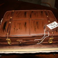 Suitcase Made for a travel themed wedding shower with chocolate marshmallow fondant.