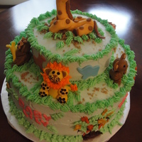 "Zoo Animals This was a 2 layer, 10"" cake with a 6"" layer on top. It was a chocolate cake with Chambord and Raspberry filling and decorated..."