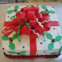 Christmas Gift This is a buttercream frosting with fondant trim. I looked at several cakes on CC site and came up with my own.
