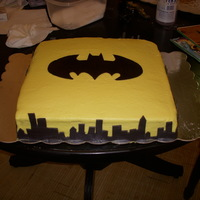 Batman This was a carrot cake with the crusting cream cheese icing. The accents are fondant. I feel like I'm getting better at this :)