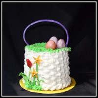 Easter Basket White chocolate cake with strawberry filling and white chocolate buttercream. The flowers, eggs, and handle are fondant/gumpaste. I didn&#...