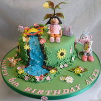 Dora The Explorer Cake This was for a friends granddaughter, who since she was one has been mad on Dora. Everything was edible, except for the tree which I wired...