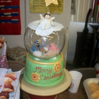 Snow Globe  Snow globe with the manger scene in it. all edible except for the glass bowl. I put a sifter under the fondant top with powdered sugar in...