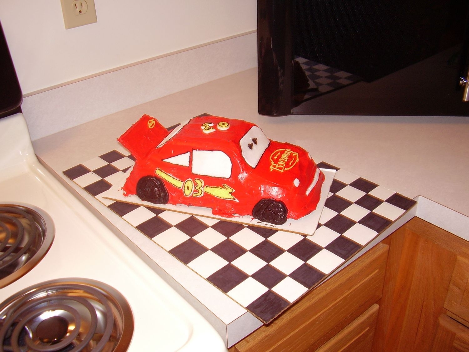 Lightning Mcqueen I made this for my 3yr olds birthday. It was my first car cake. I used the car pan. It's not the greatest but he loved it. The windows...