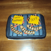 Grill Cake for the hubs birthday. cake is strawberry/lemon with lemon BC. hotdogs, hamburgers and grate are all fondant. flames are also fondant....