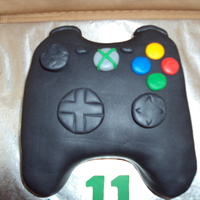 Xbox Controller chocolate cake w/ milk chocolate BC. fondant was tinted black for main piece and button. joysticks and buttons are also fondant. ENJOY!!
