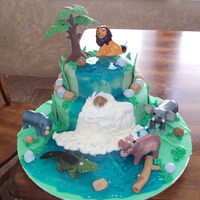Safari Baby Shower Cake lions and hippos and crocs OH MY!!! this is for a safari themed baby shower. mommy wanted vanilla on vanilla, but i added a twist with...