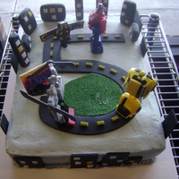 Transformers This was a cake for a 5th birthday. He wanted Transformers and some of them battling. I had a different idea for the cake, but this is what...