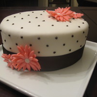 Pink Daisies With Brown Ribbon  This cake was made as a quick back up for Easter because I was afraid my Easter cake was not going to work out! It is a carrot cake with...