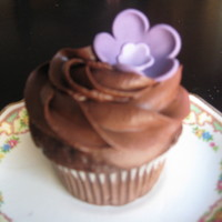 Chocolate Cupcakes With Flowers   Chocolate cupcakes with pink and purple fondant flowers.
