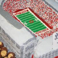 Osu Stadium Groom wanted a cake that looked like the OSU Stadium but didn't want any fondant. This is done completely in buttercream. Of course it...