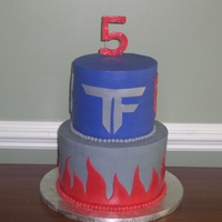 Transformers Birthday Cake Bottom Layer is Double Fudge and Top is Cherry Chip.. All BC with Fondant accents. This was my son's 5th Birthday cake and he loved it...