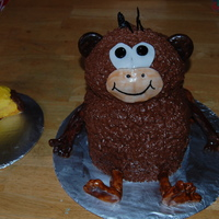Monkey With Banana all edible...cake, fondant, icing....the banana was for the 1 year old birthday boy to eat himself...