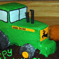 John Deere Tractor made this for my nephews 1 year birthday...everything was edible...fondant, buttercream, cake...the tractor itself was cake, as was the &...