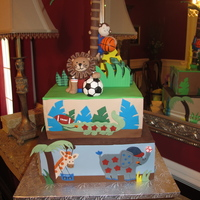 Safari Cake All animals and decorations on cake are made of fondant or gumpaste. This baby shower cake was made to replicate the Lambs and Ivy Team...