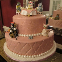 Kitty Tea Party Cake All cat's and accessories are made of fondant or gumpaste.