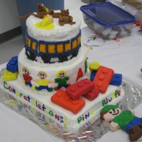 Day Care Grand Opening Cake My sister and I made this cake for my Mom's Day Care Grand Opening. Cakes are covered with buttercream, lego's are Rice Krispie...