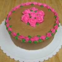 Rose Cake With Chocolate Buttercream I love this cake. The frosting was sooooo good :D I made this for my boyfriends mother.