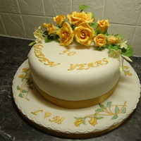 Golden Wedding Anniversary Cake - Brother And His Wife 8 inch fruit cake,covered in ivory fondant with a wired spray of Golden roses and jasmine - the roses are dusted with edible gold lustre...