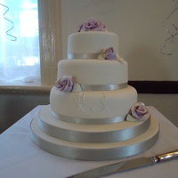 Three Tier Round Wedding Cake Three tier madiera cake - ten, eight and six, filled with raspberry jam and buttercream, undercoated with white chocolate ganache, and iced...