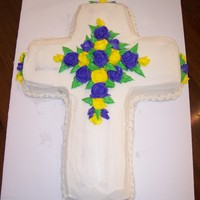Cross Cake Simple cross cake with buttercream flowers.