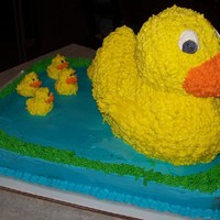 Duck Cake I used an 11x14 sheet cake with a 3-D duck cake on top. The little ducks are cupcake picks with icing piped on them.