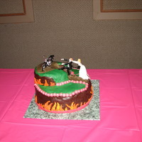 Harley Davidson Grooms Cake  I made this cake for a friend who was getting married and wanted a grooms cake that had a motorcycle theme. I used a 12x3 inch pan for the...