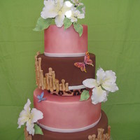 Tropical Wedding Hand painted leopard dividers, fondant bamboo pieces & gumpaste flowers/butterflies. Torpical theme