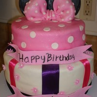 Minnie Mouse Cake This cake was done for a two year old's birthday party. I was working on a limited budget so instead of using all fondant accents I...